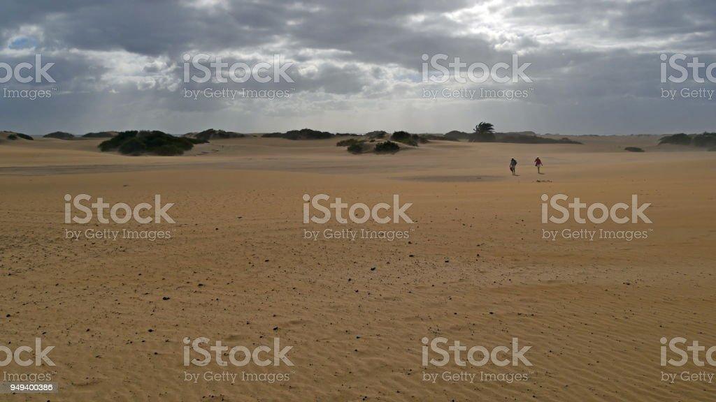 Dunas de Maspalomas - Gran Canaria - Spain - at storm - dark sky - lonely walker stock photo