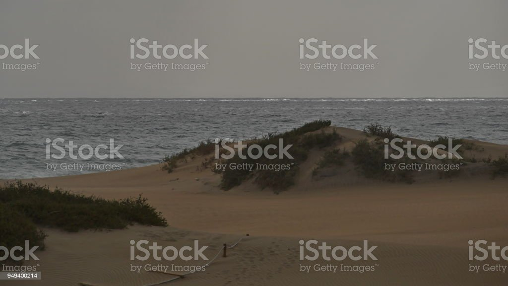 Dunas de Maspalomas - Gran Canaria - Spain - at storm - gray sky - wild sea stock photo
