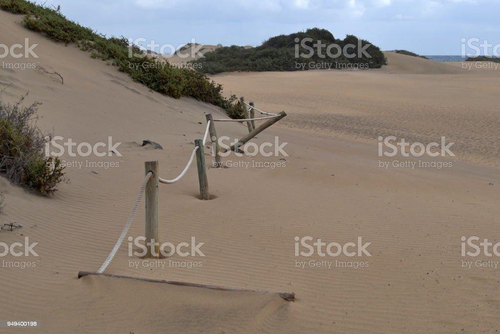 Dunas de Maspalomas - Gran Canaria -Spain - at storm - overgrown dune - rope barrier stock photo