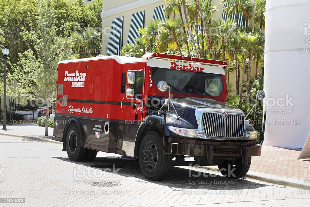 Dunbar Armored truck on city street stock photo
