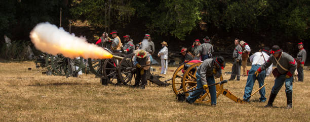 Duncan Mills, Calif / July 14, 2012: Men fire canon Duncan Mills, Calif / July 14, 2012: Men fire canon during Civil War Reenactment american civil war stock pictures, royalty-free photos & images