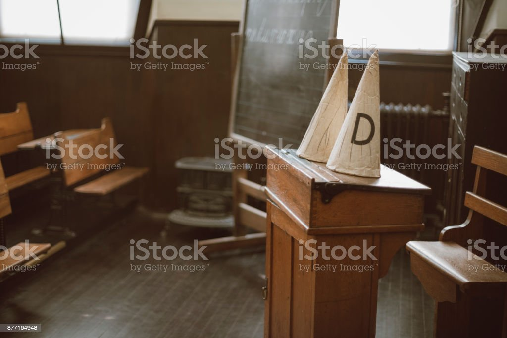 Dunce Caps in an Old School Classroom stock photo