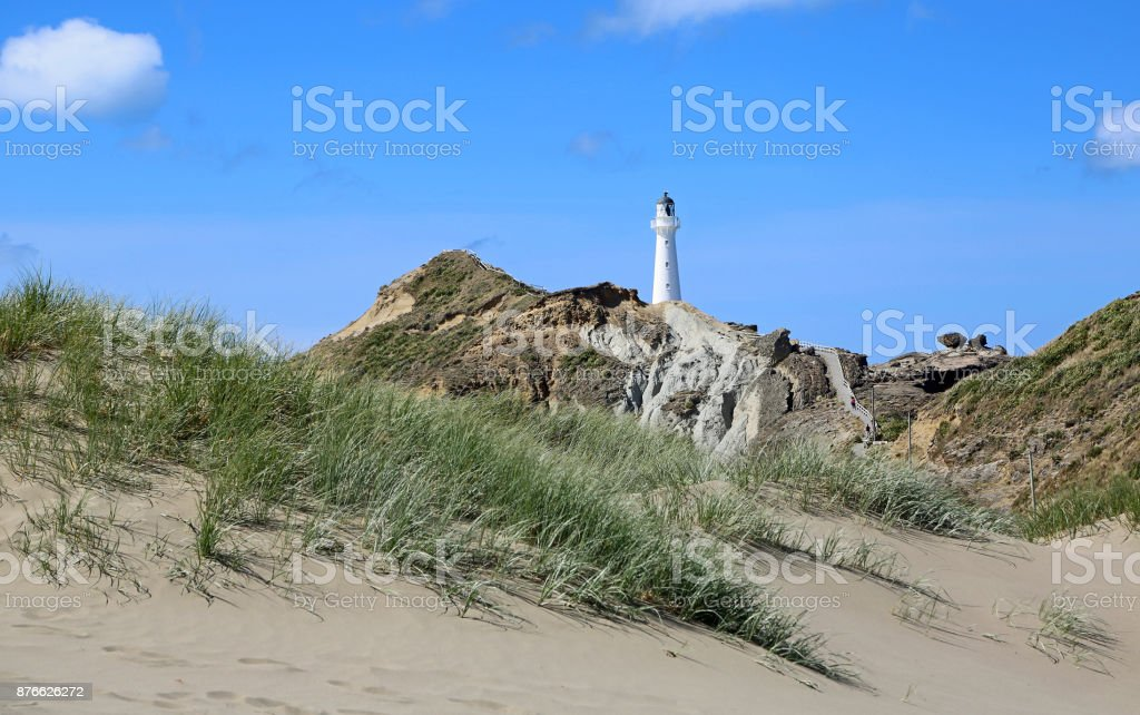 Dune and the lighthouse stock photo