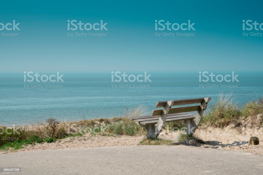 dune landscape with bench on beach Burgh Haamstede, The Netherlands stock photo