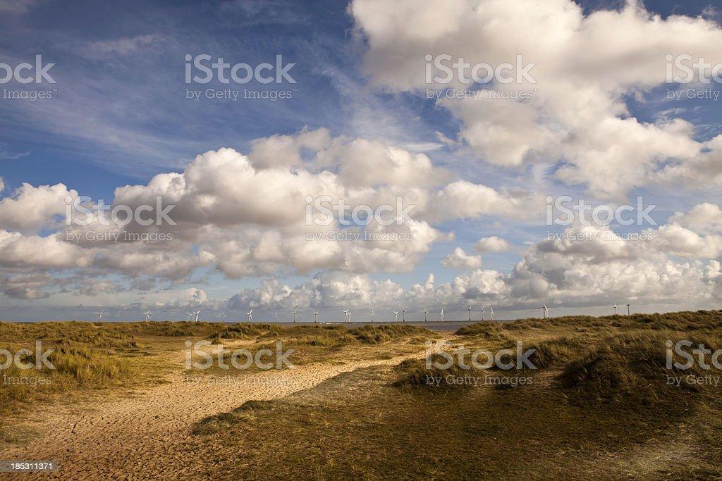Dunes and windfarm stock photo