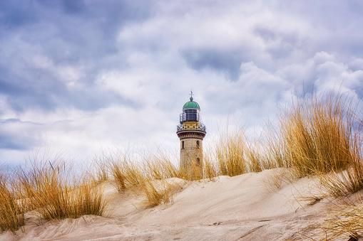 Dunes of Warnemünde with lighthouse.