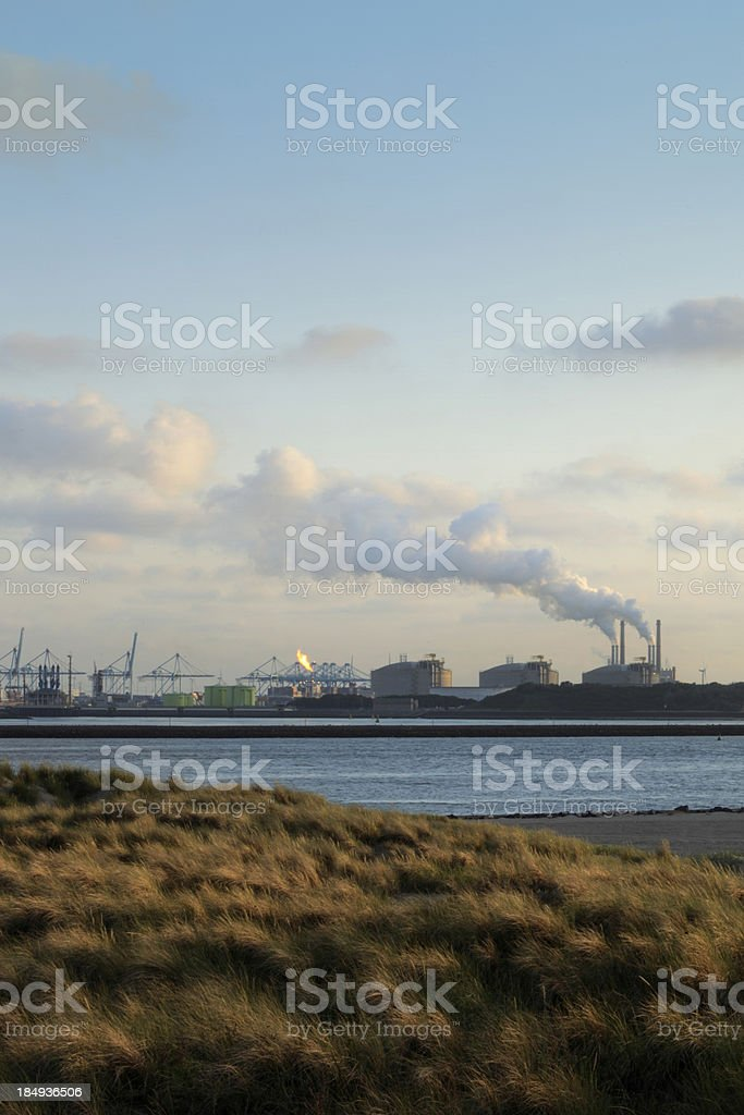 dunes with the Europoort industrial area royalty-free stock photo