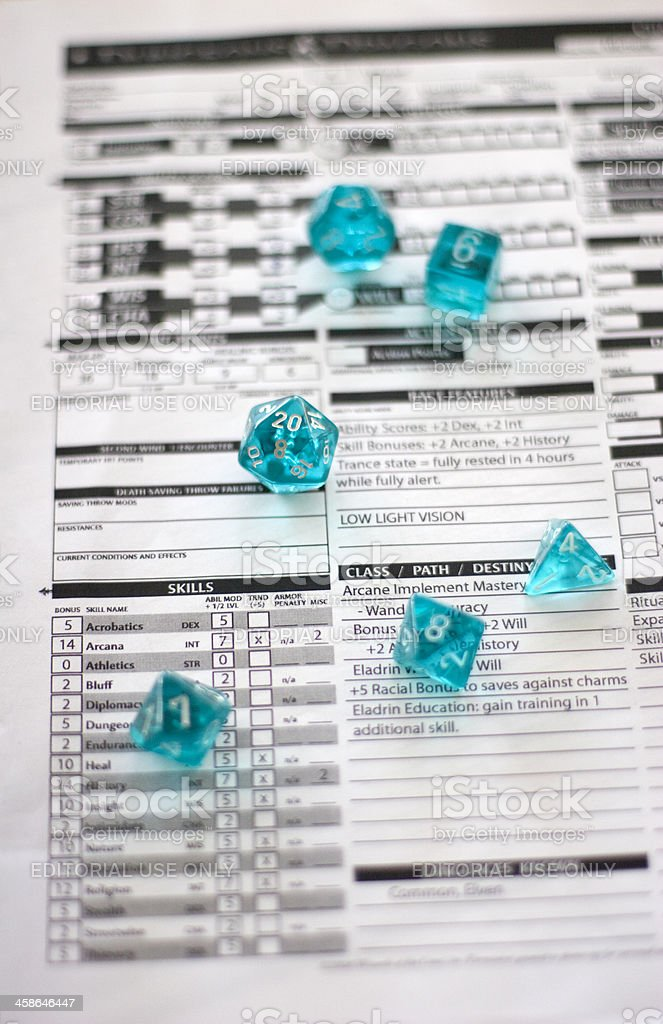 "Dungeons & Dragons Character Sheet And Dice (How I Roll) ""Seattle, WA, USA - October 23, 2011:A Dungeons & Dragons Role Playing Game (RPG) character sheet and dice are laid out before the start of a gaming session. Dungeons & Dragons is a pencil and paper RPG (copyright of Wizards of The Coast) where players create complex characters who work together to achieve goals and progress through the narrative created by the group\'s Dungeon Master (DM). The game prides itself on the endless possibilities and choices available to adventuring characters as the world itself is limited only to player\'s imaginations."" Alternative Lifestyle Stock Photo"