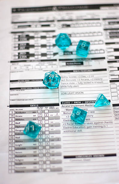 Dungeons & Dragons Character Sheet And Dice (How I Roll) stock photo