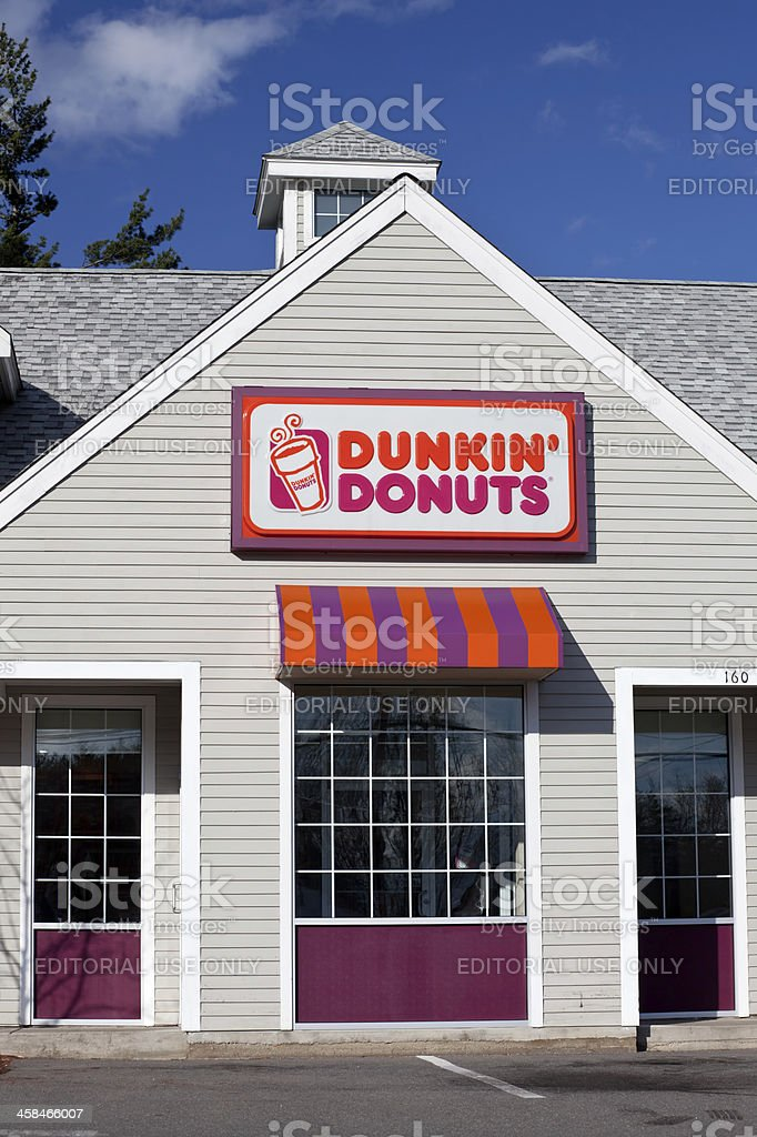 Dunkin' Donuts Store front Derry, New Hampshire, USA - April 17, 2011: Dunkin' Donuts Store front in Derry, NH. Dunkin' Donuts is an international doughnut and coffee retailer. Advertisement Stock Photo