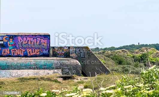 Dunkirk, France - June 2, 2019: Dunkirk Beaches Bunkers with illegal graffiti - remains of a WW2 Nazi coastal gun battery, known as M.K.B Malo Terminus