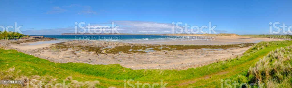 Dunnet Beach, a sweeping arc of white sandy beach backed by rolling sand dunes on the north coast of the Scottish Highlands stock photo