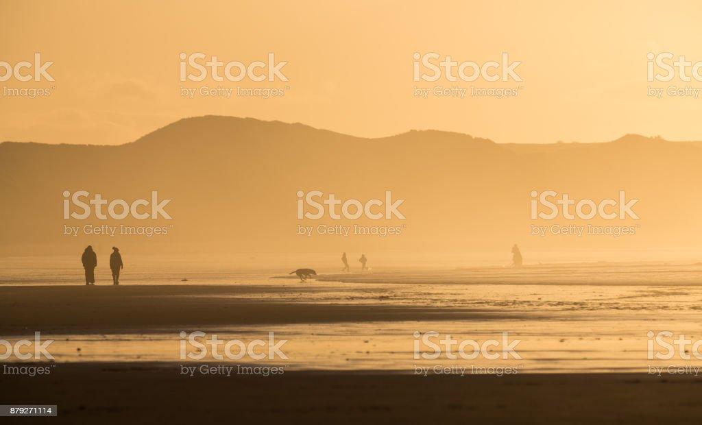 Dunnet beach sunset walkers stock photo