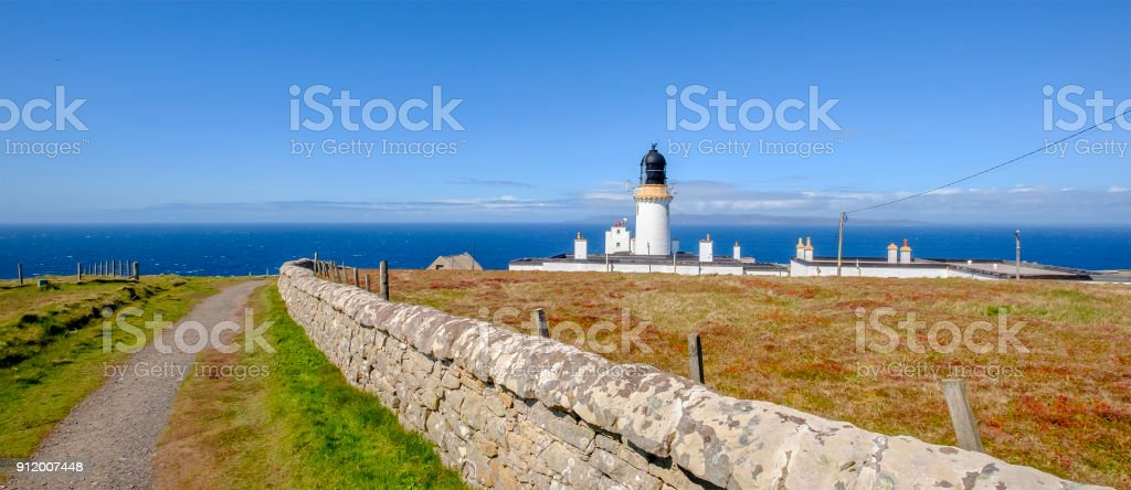 Dunnet Head Lighthouse, an active lighthouse built in 1831 on Dunnet Head top cliff, on the north coast of the Scottish Highlands stock photo