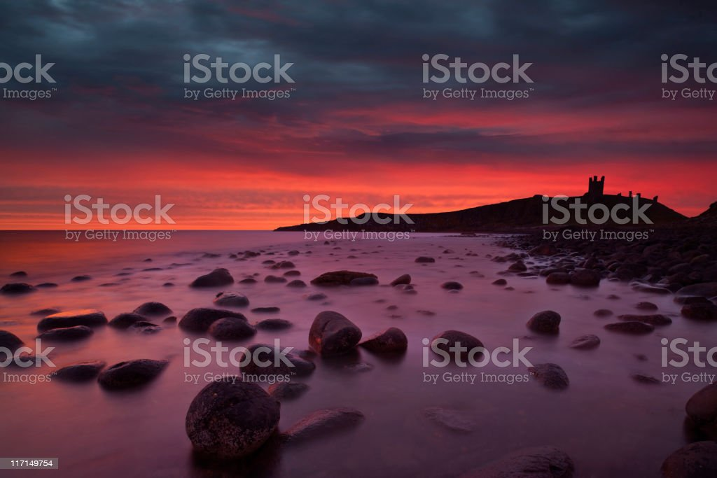 Dunstanburgh Castle at Dawn. stock photo