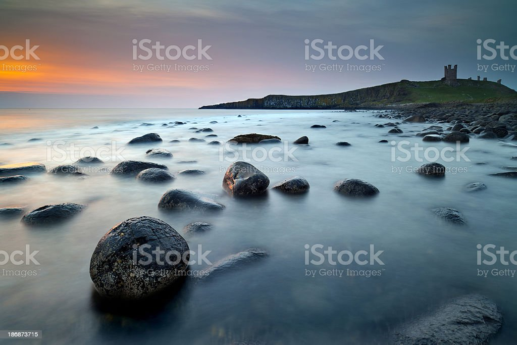 Dunstanburgh Castle at Dawn. royalty-free stock photo