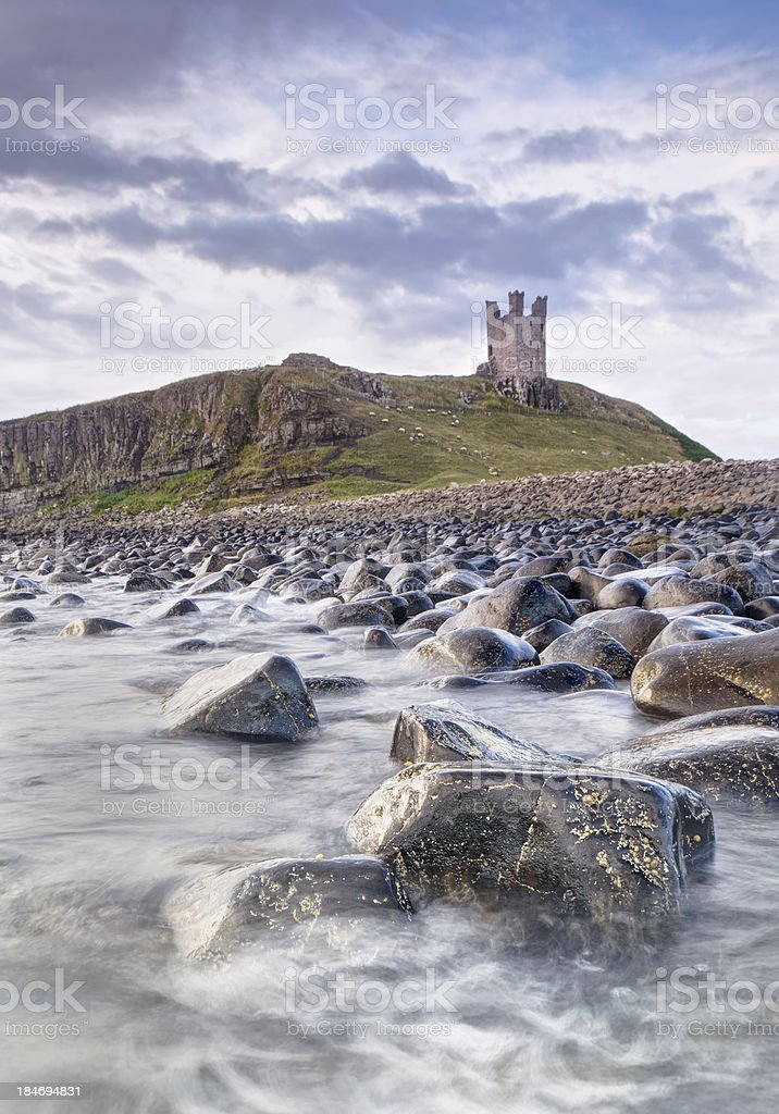 Dunstanburgh Castle Boulders stock photo