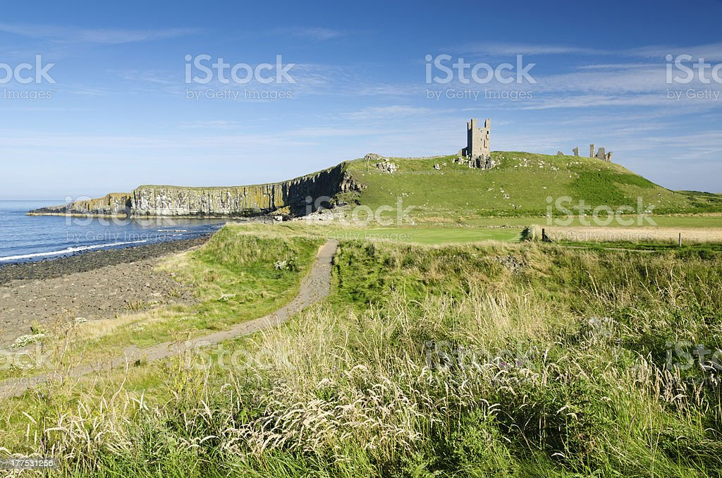 Dunstanburgh Castle from 13th tee stock photo