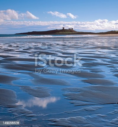 istock Dunstanburgh Castle from Embleton bay 149058528