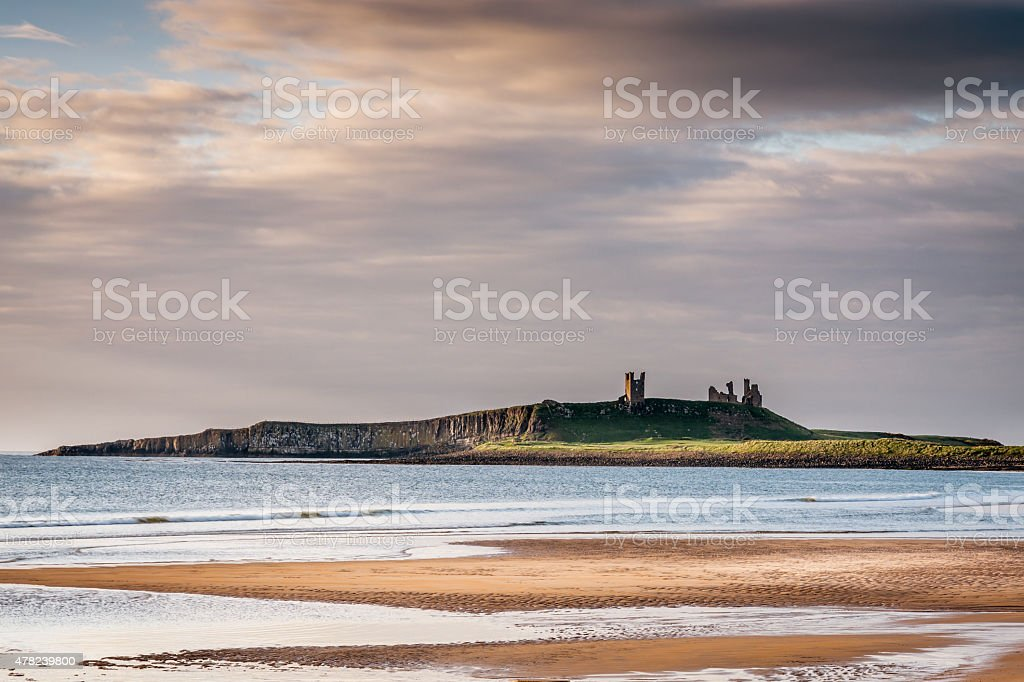 Dunstanburgh Castle from Embleton Bay stock photo