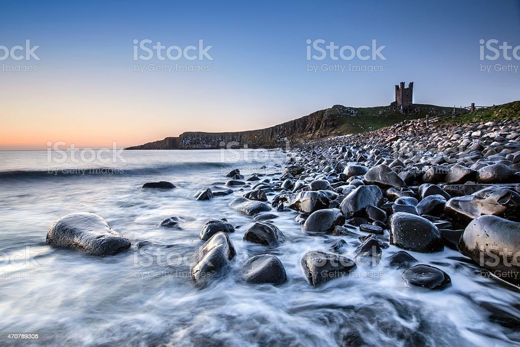 Dunstanburgh Castle Ruins stock photo
