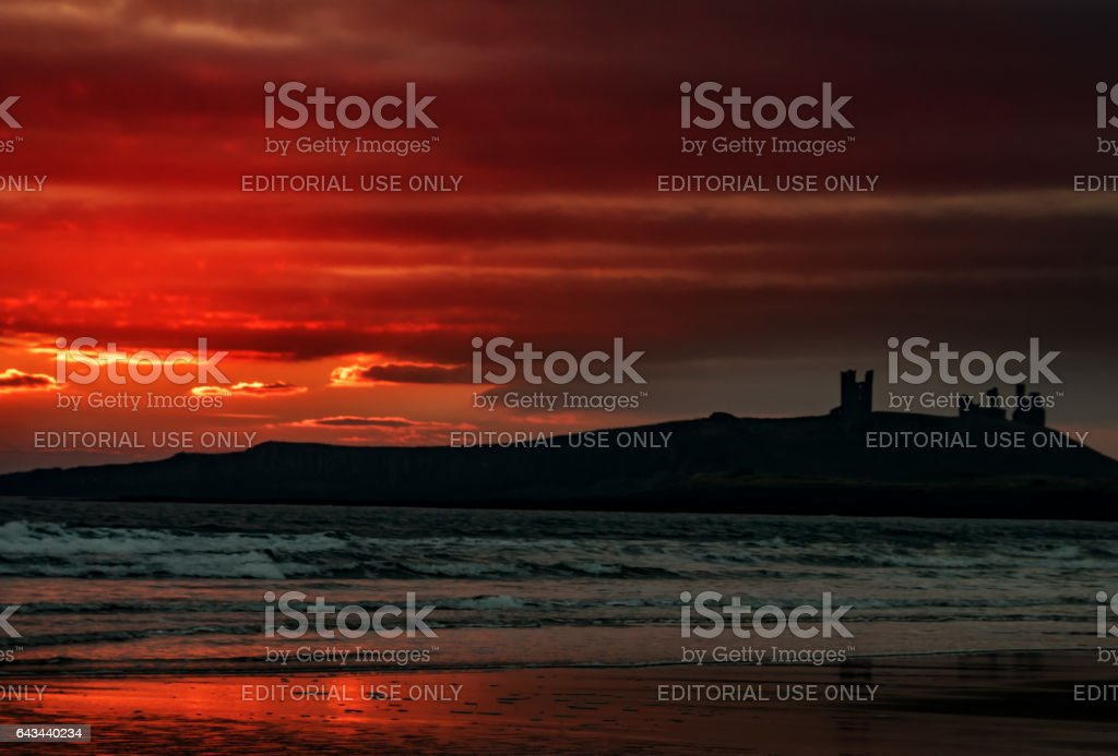 Dunstanburgh dawn stock photo
