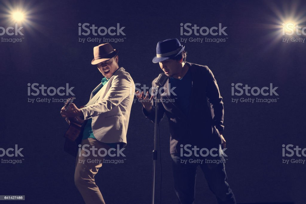 Duo musician in dark with lens flare effect stock photo