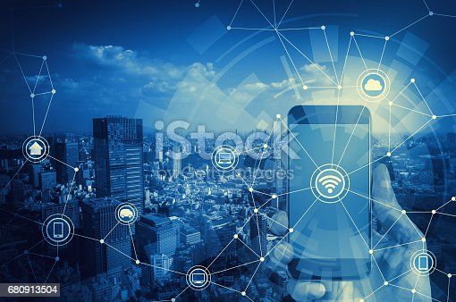 istock duo tone graphic of smart phone and smart city, wireless communication network 680913504