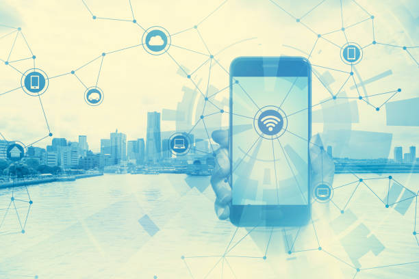 duo tone graphic of smart phone and smart city, wireless communication network, abstract image visual stock photo