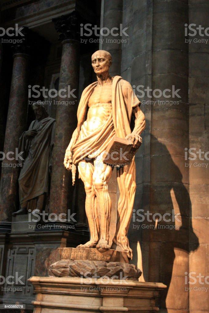 MILAN, ITALY - Duomo Cathedral Iconic Interior Sculpture Saint Bartholomew stock photo