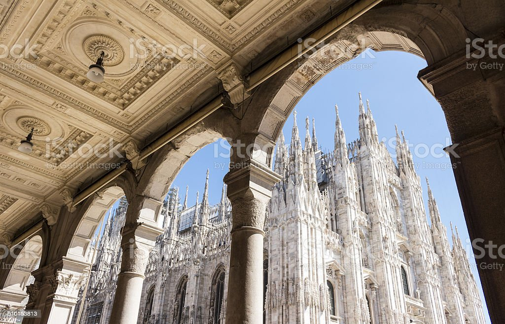 Duomo of Milan, Italy. Piazza del Duomo. Looking up from Portico (walkway supported by columns,colonnade) Architectural Column Stock Photo