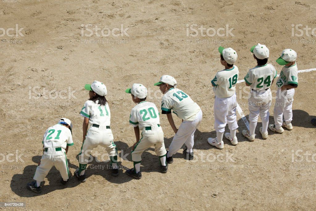 Duplicate boy baseball player stock photo
