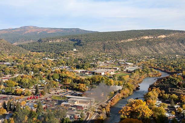 Durango, CO with the train next to the river View of Durango from the Rim Trail.  Narrow gage railroad running next to the Animas River animas river stock pictures, royalty-free photos & images