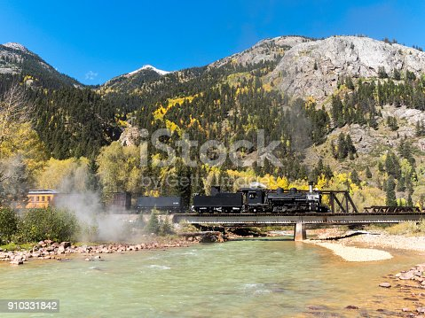 The Durango & Silverton Narrow Gauge Railroad (D&SNG) travels between Durango, Colorado and Silverton, Colorado with its vintage steam locomotives. This is in the San Juan Mountains and near the Animas River. These great excursion passenger trains are enjoyed by a large number of people each day, with most starting from the Durango Depot. Photo edited to remove names and numbers.