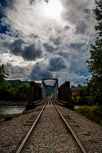 Durango Railroad Crossing Bridge over Animas River Durango Railroad Crossing Bridge over Animas River before the EPA spilled 3 million galloons of Toxic mining sludge animas river stock pictures, royalty-free photos & images
