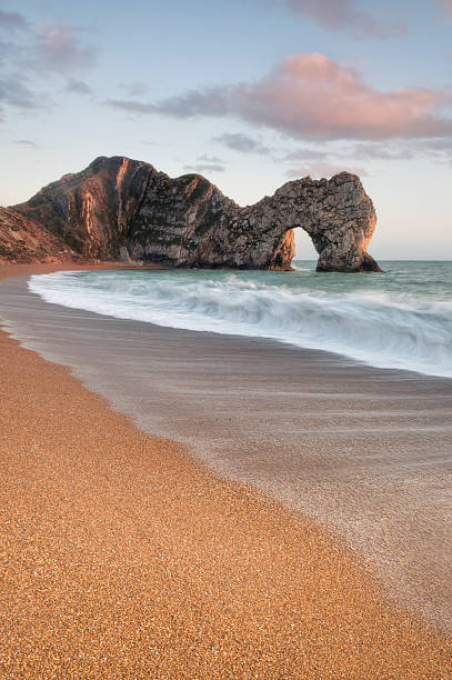 durdle door breakers - weymouth stock photos and pictures