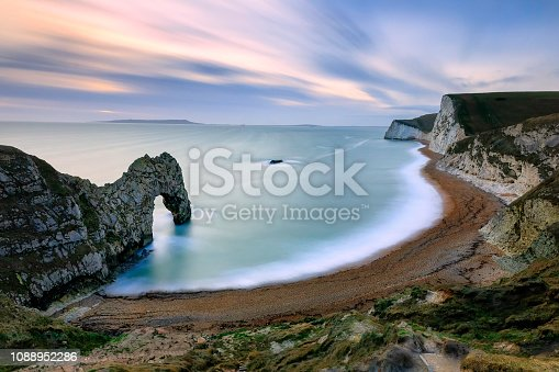 A natural limestone arch on the Jurassic Coast near Lulworth in Dorset, Long exposure