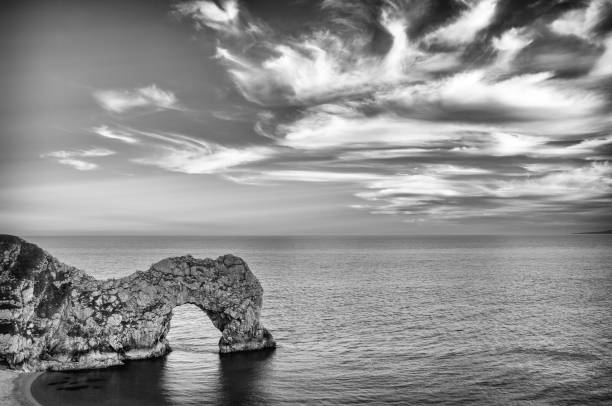 durdle door in black and white stock photo