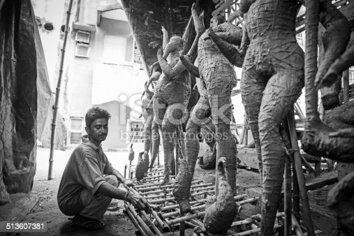 Indian deity - Goddess Durga idols being prepared by artisans for the festival Durga Puja. Artisans from West Bengal-India come to Delhi every year to make these idols for the Durga Puja Festival in Delhi. Its a 5 day long festival which ends with the immersion of these idols in the river.