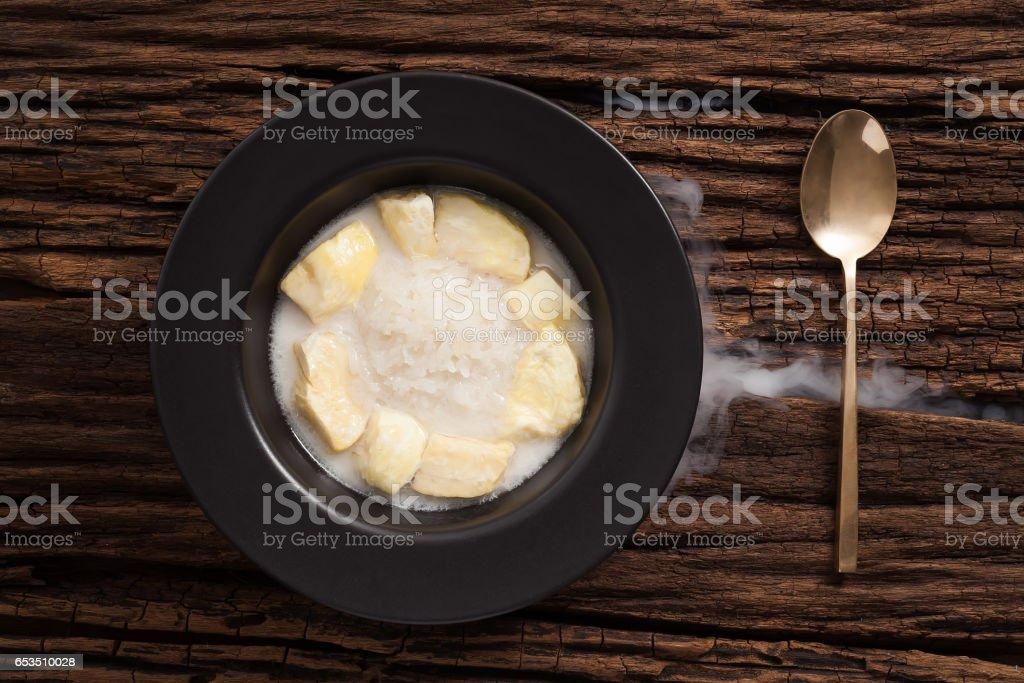 durian coconut milk sticky rice still life on wooden background stock photo
