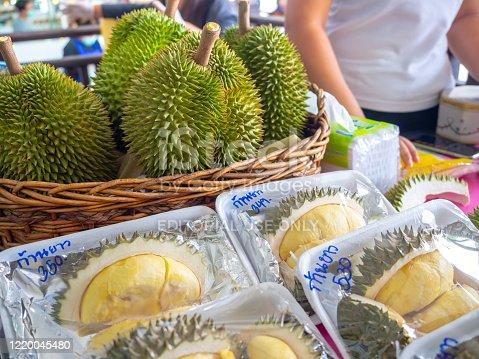 Bangkok, Thailand - April 14, 2020: Durian in basket and packaging for sale at street food market in Bangkok, Thailand.