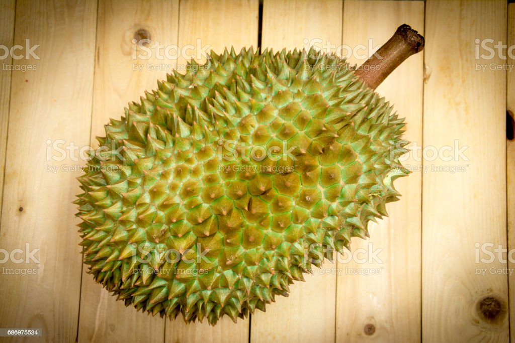 durian mon thong is king of fruits. On wood background Lizenzfreies stock-foto