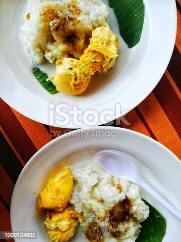 Malaysian delicacy. Durian served with sticky rice, coconut milk and sugar.