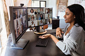 istock During COVID-19, attractive woman gestures during virtual meeting with colleagues 1293927641