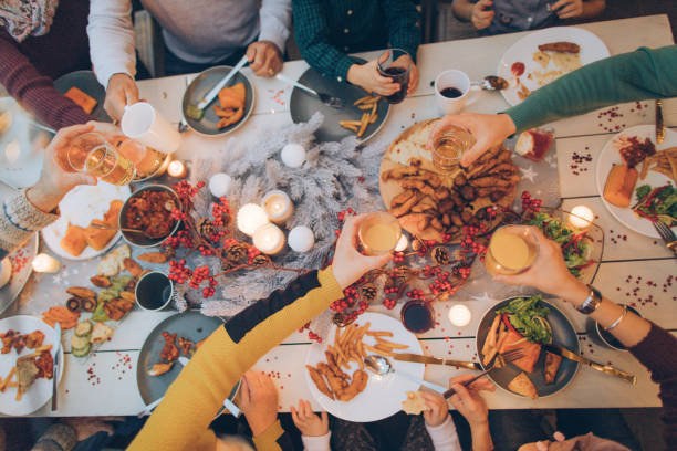 during the celebration.. - dining table stock photos and pictures