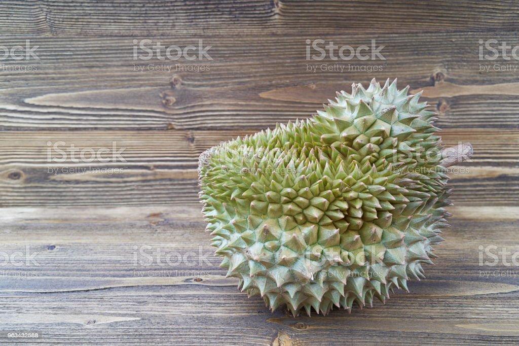 Durio zibethinus ou Durian sur fond de texture en bois marron jane - Photo de Agriculture libre de droits