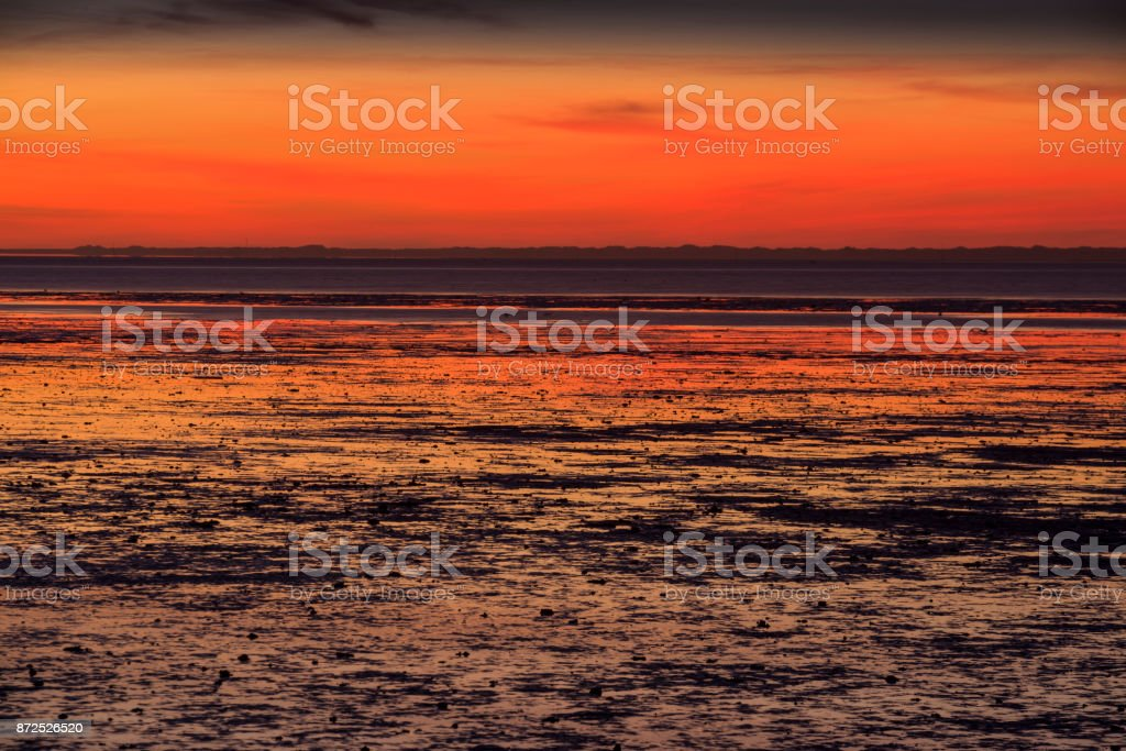 Dusk and low tide at the German North Sea, Wattenmeer National Park stock photo