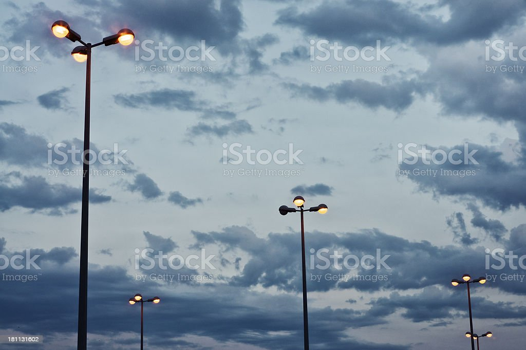 Dusk and streetlamps royalty-free stock photo