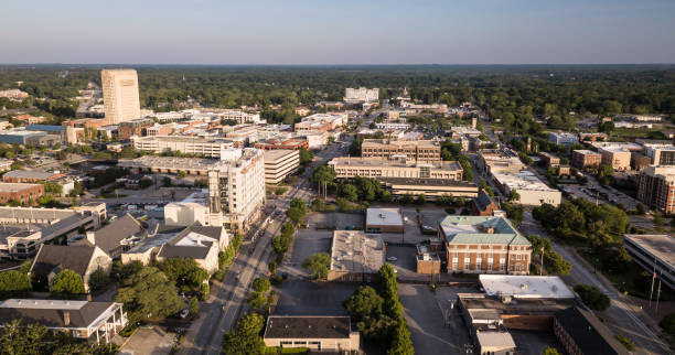Dusk Comes to Main Street in Spartanburg South Carolina The roads and buildings are seen from this aerial view of Spartanburg SC spartanburg stock pictures, royalty-free photos & images