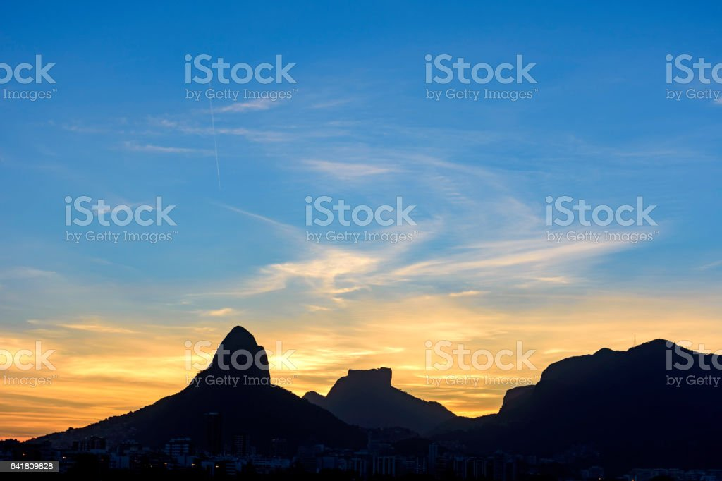 Dusk in Two Brothers hill and Gavea Stone stock photo